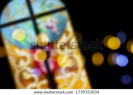Blur image of stained glass church window with bokeh. Blur picture of Holy grail.