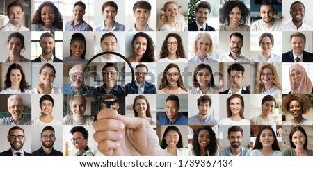Male hr manager holding magnifying glass head hunting choosing finding new unique talent indian female candidate recruit among multiethnic professional people faces collage. Human resources concept. #1739367434