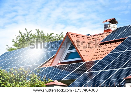 solar panels, Close up shot of a solar panel array with blue sky, Solar panels on a roof for electric power generation, Solar panel on a red roof reflecting the sun #1739404388