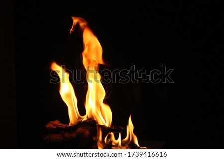 Separate flames on a black background, moving normally, night wind force / natural red lights are closely yellow, orange Flames of energy flare,