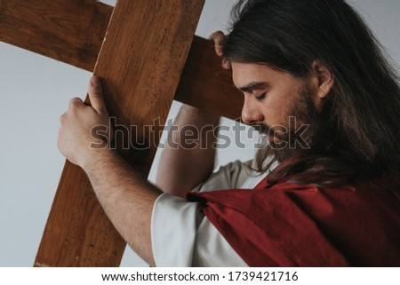 Picture of Jesus carrying his cross during way of the cross