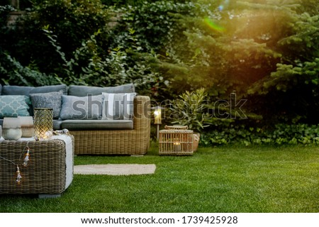 Early summer evening in the garden of single family home Royalty-Free Stock Photo #1739425928