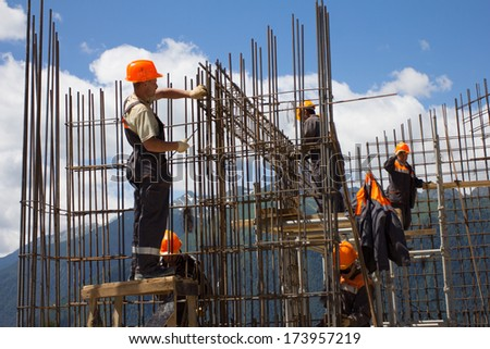 SOCHI, RUSSIA - JUNE 18, 2012: Workers make reinforcement for concrete wall #173957219