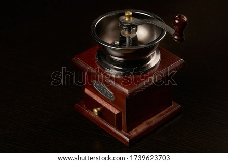 Manual coffee grinder for grinding coffee beans. Black background. Vintage coffee grinder Royalty-Free Stock Photo #1739623703