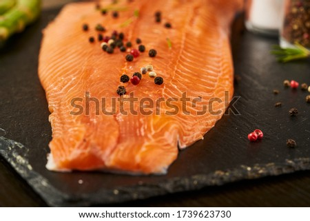 Salmon with black pepper on plate close up. Royalty-Free Stock Photo #1739623730