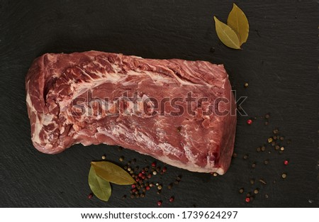 big pork raw meat piece ready for cooking. a piece of pork Royalty-Free Stock Photo #1739624297