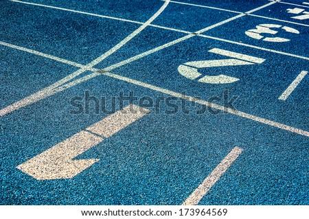 background of the start line of blue running tracks #173964569