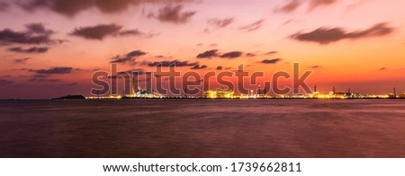 Beautiful scenery of the sea and industrial estates in Twilight Time.Long exprosure picture style.
