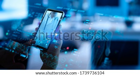Telemedicine concept,Hand holding smartphone Medical Doctor online communicating the patient on VR medical interface with Internet consultation technology. Royalty-Free Stock Photo #1739736104