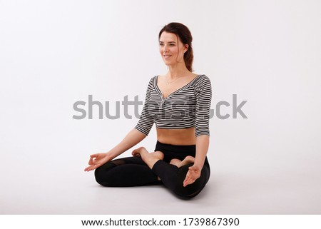 woman in lotus position on a white isolated background. international yoga day