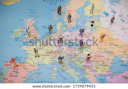 Many figures of people are placed on Europe map. Open borders concept. Royalty-Free Stock Photo #1739879435