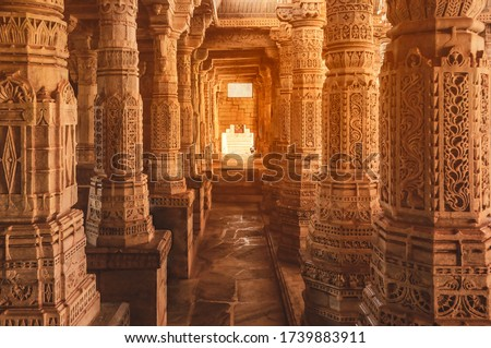 Bas-relief at columns at famous ancient Ranakpur Jain temple in Rajasthan state, India Royalty-Free Stock Photo #1739883911