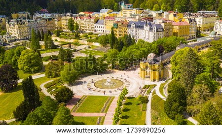 Aerial view of Marianske Lazne spa (Marienbad). Fountain in spa colonnade from above. Karlovy Vary Region of the Czech Republic, European union. Famous spa town with curative carbon dioxide springs. #1739890256