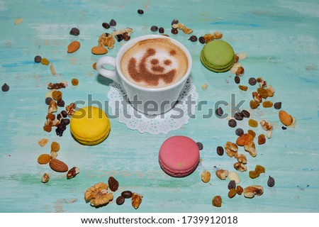 cup of coffee with panda picture - made with cinnamon and late foam