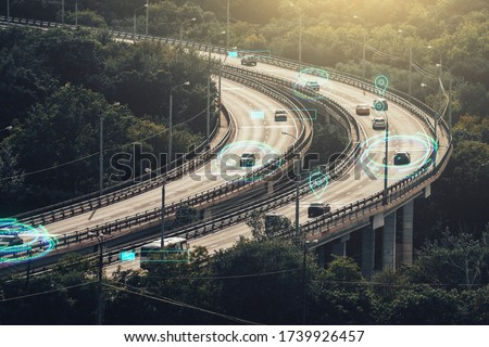 Autonomous Self Driving Cars Concept. Cars move on city road and Artificial Intelligence controls vehicles in traffic. Royalty-Free Stock Photo #1739926457