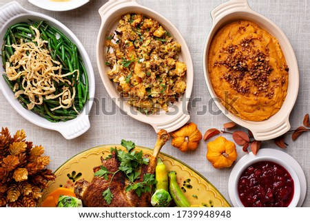 Traditional Thanksgiving sides, green beans casserole, stuffing and sweet potatoes Royalty-Free Stock Photo #1739948948