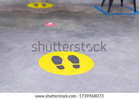 Footprint sign for stand in the mall.Social Distance word sticker poster.Social Distancing 6 Ft. Instruction against the Spread.New normal Reopen Mall.Social distancing in the workplace during covid19 Royalty-Free Stock Photo #1739968073