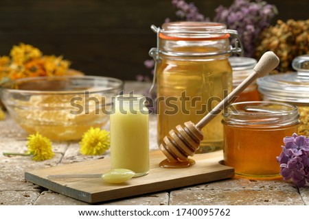 Royal jelly and honey background Royalty-Free Stock Photo #1740095762