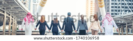 Group of people diversity multiethnic teamwork collaboration team meeting communication  Unified team concept. Business people hands together diversity multiethnic diverse culture partner team meeting Royalty-Free Stock Photo #1740106958