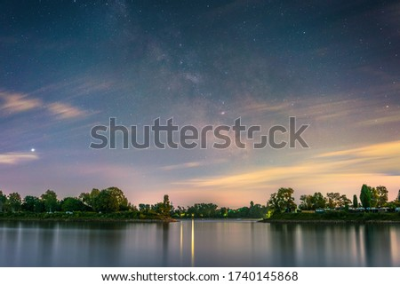 The galactic center photographed from the shore of the river Rhine at Mannheim in Germany.