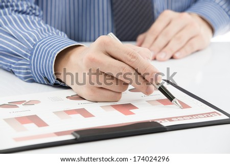 business report and man hand with pen #174024296
