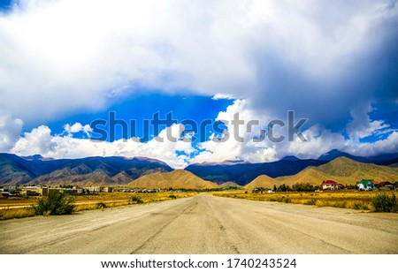Mountain valley road landscape Road in mountain valley #1740243524