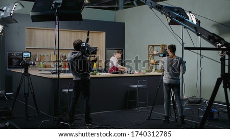 WIDE Behind the scenes of studio set, shooting TV television cooking show featuring celebrity chef, professional TV production #1740312785