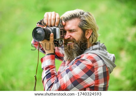 Enjoying hot day. bearded man hipster take photo. photo shooting outdoor. brutal man traveler with retro camera. photography in modern life. travel tips. professional photographer use vintage camera.