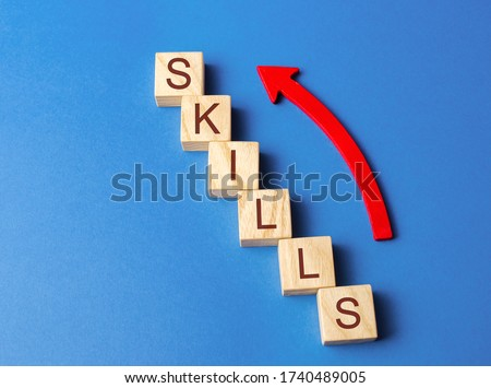 Wooden blocks with the word Skills and up arrow. Knowledge and skill. Self improvement. Education concept. Training. Leadership skills. Human abilities. Growth, increase Royalty-Free Stock Photo #1740489005