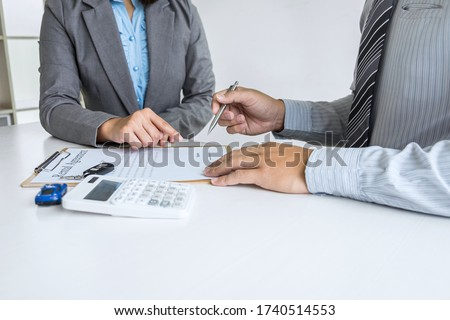 Realtor agent manager pointing rental contract form to businessman client for decide signing to agreement, renting considering vehicle car insurance.