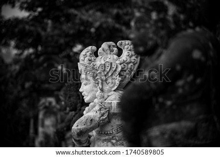 black and white picture of sculptures in bali temple
