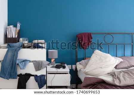 Picture of an untidy bedroom  Royalty-Free Stock Photo #1740699653