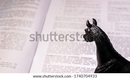 An educated horse reviews a contract.