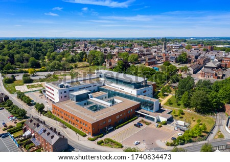 Aerial photo of the Pontefract Hospital located in the village of Pontefract in Wakefield in the UK on a sunny summers day showing the Hospital and grounds with a blue sky and white clouds in the sky