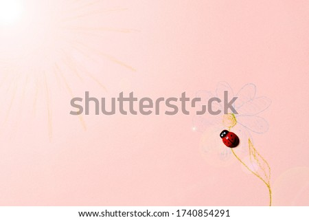 Lonely ladybug looking for the simulated sun and sitting on an artificial flower and dreaming about a better life. Conceptual picture and symbolism of virtual reality