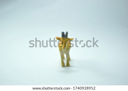 this pic show the old plastic animal toys model, it's a goat with white color background