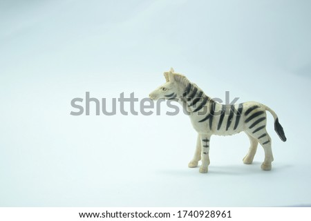 this pic show the old plastic animal toys model, it's a zebra with white color background
