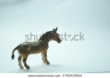 this pic show the old plastic animal toys model, it's a donkey with white color background