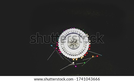 Color Sewing Needles or  Equipment for Seamstresses Different Types. isolated on a black background.