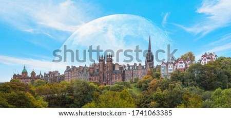 """Panoramic view of Historic Old Town of Edinburgh with full moon """"Elements of this image furnished by NASA #1741063385"""