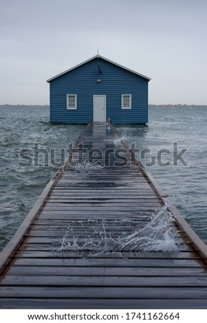 Blue boat house on the Swan River in Perth. Blue boat shed in Storm from cyclone mangga. Perth, Western Australia #1741162664