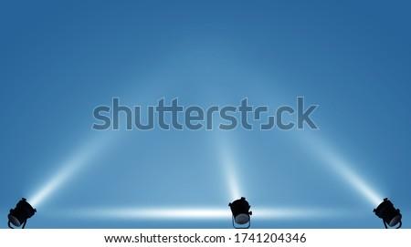 Spotlights illuminate empty stage blue background. Royalty-Free Stock Photo #1741204346