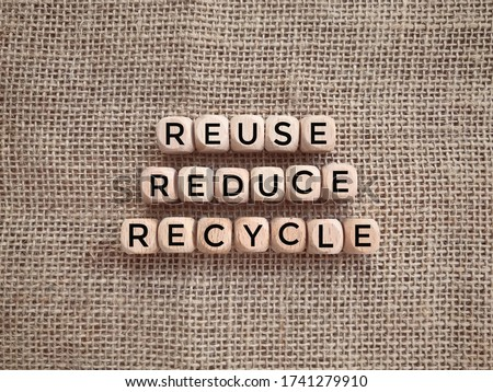 Environmental awareness and educational concept. REUSE, REDUCE and RECYCLE written on wooden blocks. Royalty-Free Stock Photo #1741279910