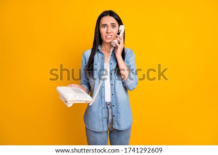 Portrait of her she nice-looking attractive pretty confused brunet girl calling dialing friend wrong number isolated on bright vivid shine vibrant yellow color background