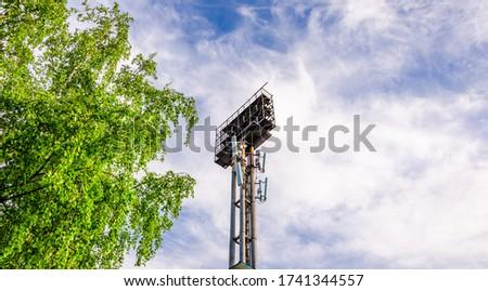 Mobile communication antennas on the mast at the stadium. #1741344557
