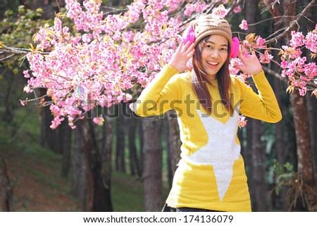 Portrait of beautiful Thai woman tourist in a spring cherry blossom garden (Khun Mae Ya). #174136079
