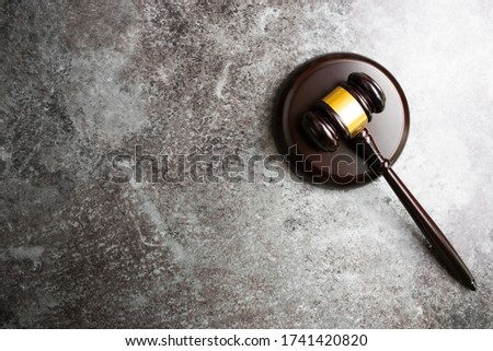 directly above view of judges gavel on marble stone table background