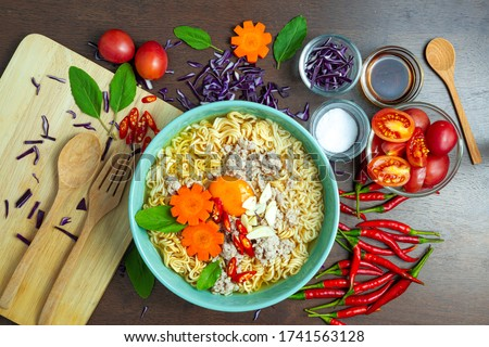 instant Noodles with Sliced pork in Creamy Tom Yum soup