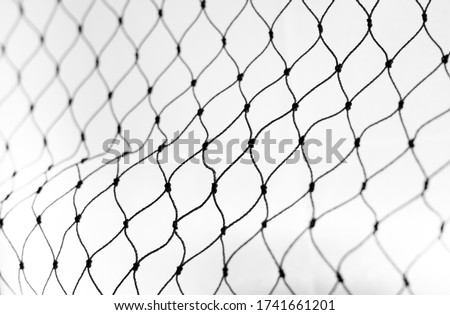 Net pattern close up. Rope net . Soccer, football, volleyball, tennis and tennis net pattern. Fisherman hunting net rope texture Royalty-Free Stock Photo #1741661201