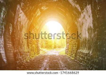 Exit from the old tunnel, no sun glare sunset. Royalty-Free Stock Photo #1741668629